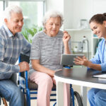 Elderly people with caregiver in nursing home